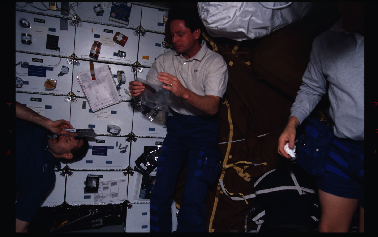 STS082-381-029 - STS-082 - Crewmember activities in the shuttle middeck on day off