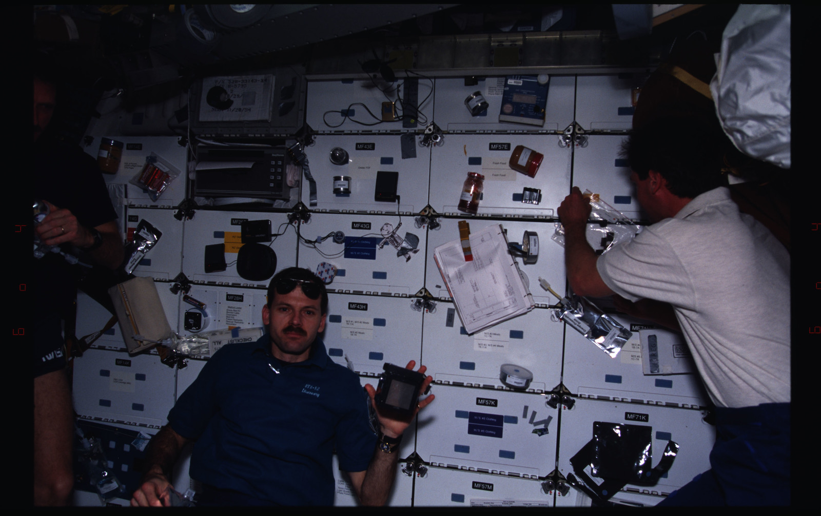 STS082-381-034 - STS-082 - Crewmember activities in the shuttle middeck on day off
