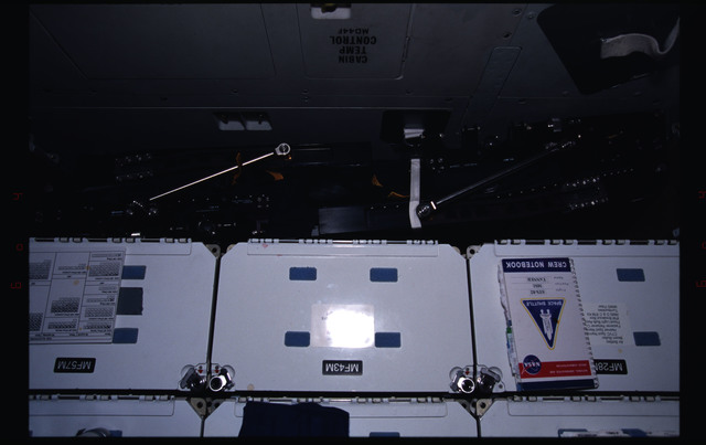 STS082-388-014 - STS-082 - New lightweight seats stowed below the forward middeck lockers