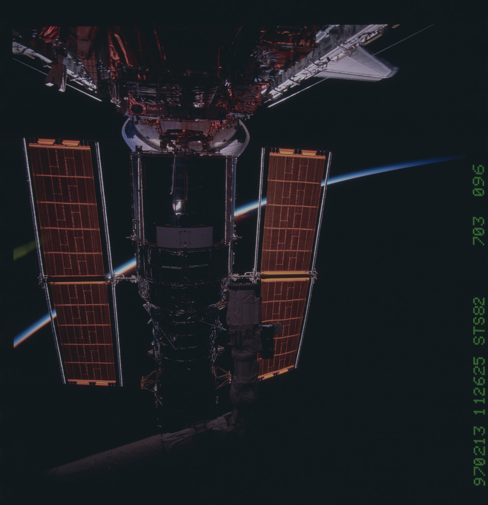 STS082-703-096 - STS-082 - HST, full length views of telescope in payload bay after capture and berthing