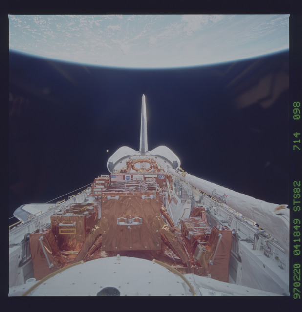 STS082-714-098 - STS-082 - Payload bay view with orbiter tail pointing at the Earth limb