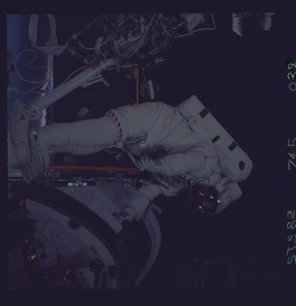STS082-745-039 - STS-082 - EVA 4 activity on Flight Day 7 to service the Hubble Space Telescope