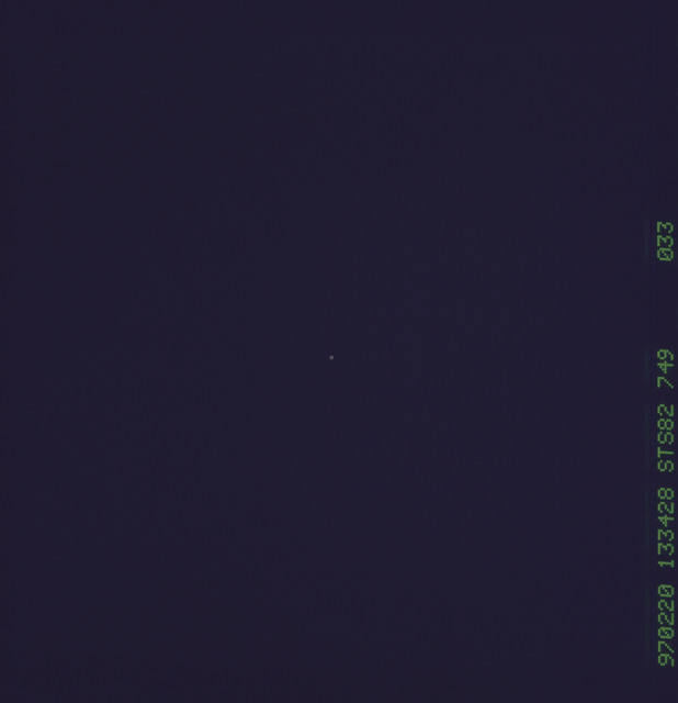 STS082-749-033 - STS-082 - Documentation of space debris the orbiter avoided