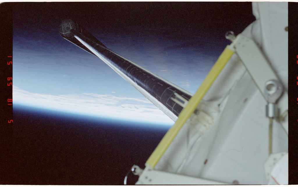 STS083-316-020 - STS-083 - View of payload bay and Earth from Spacelab module