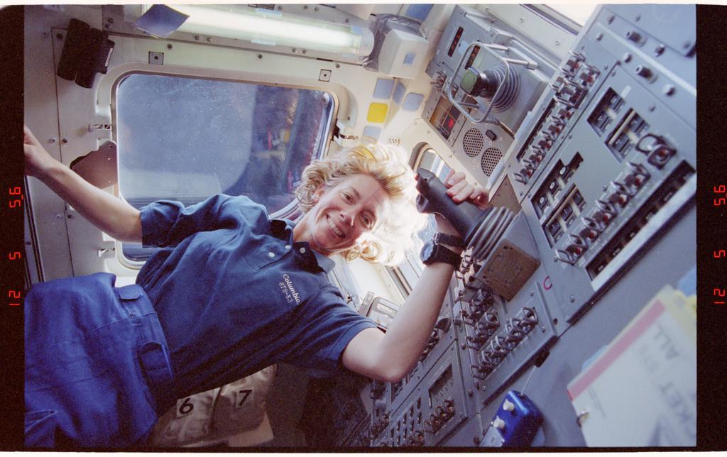 STS083-452-032 - STS-083 - Pilot Still under aft flight deck overhead windows