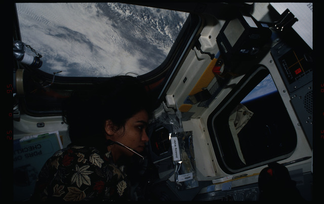 STS087-308-021 - STS-087 - Kalpana Chawla directs the EVA from inside the flight deck