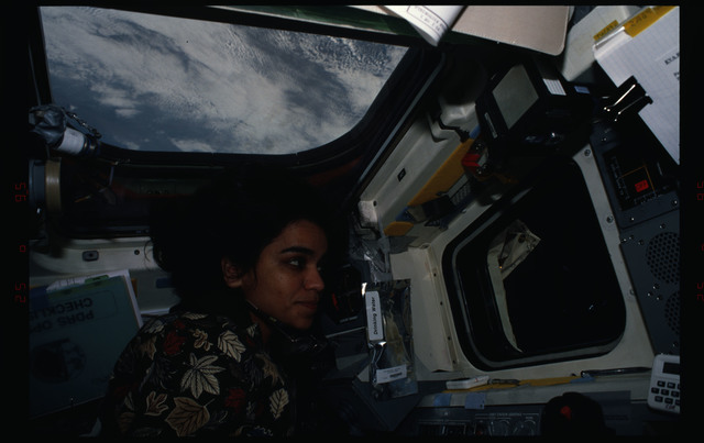 STS087-308-022 - STS-087 - Kalpana Chawla directs the EVA from inside the flight deck