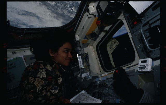 STS087-308-023 - STS-087 - Kalpana Chawla directs the EVA from inside the flight deck