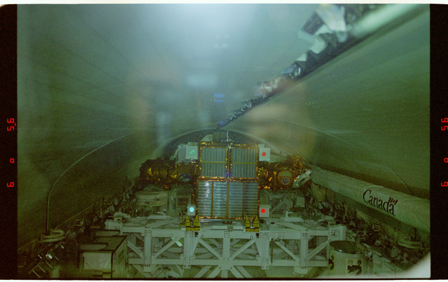 STS087-318-024 - STS-087 - Closing payload bay doors in preparation for deorbit