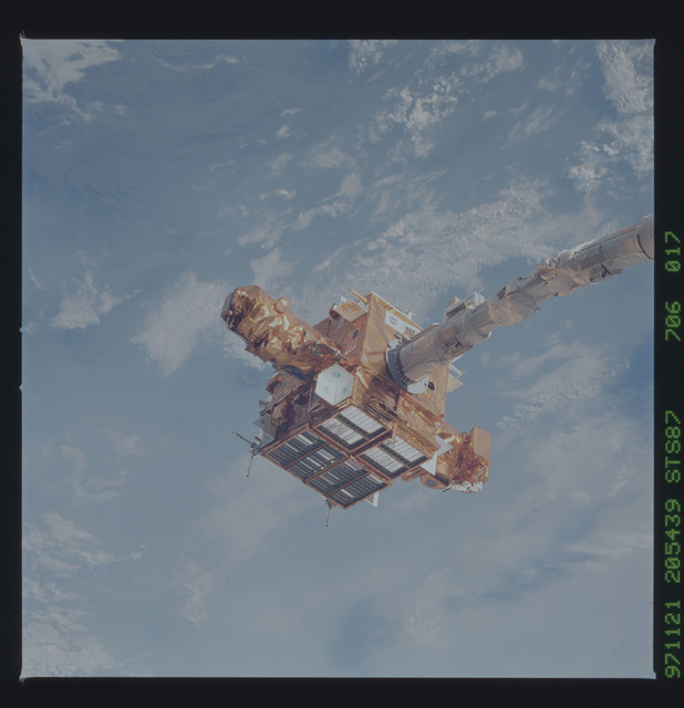 STS087-706-017 - STS-087 - SPARTAN satellite on RMS arm prior to release