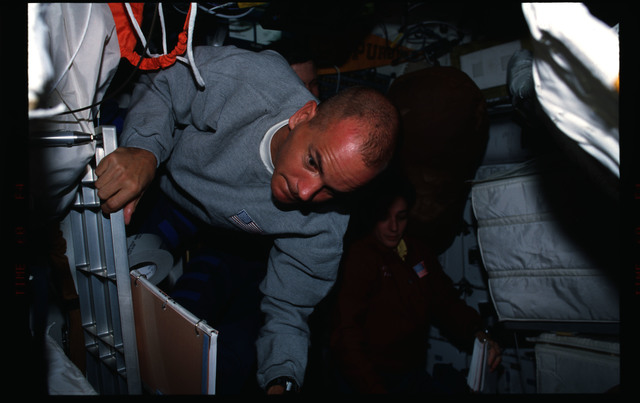 STS088-306-029 - STS-088 - Preparing for EVA on the middeck