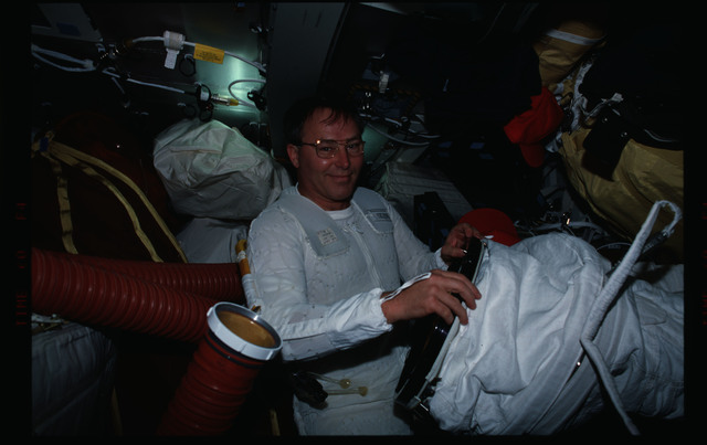 STS088-306-033 - STS-088 - Preparing for EVA on the middeck