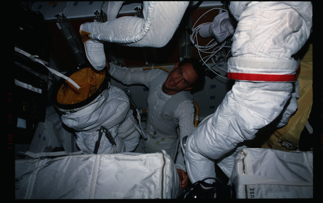 STS088-306-034 - STS-088 - Preparing for EVA on the middeck