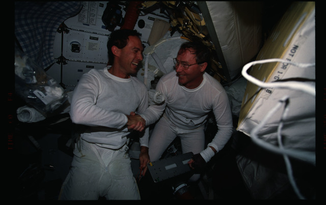 STS088-307-005 - STS-088 - Newman and Ross on the middeck after one of their EVA