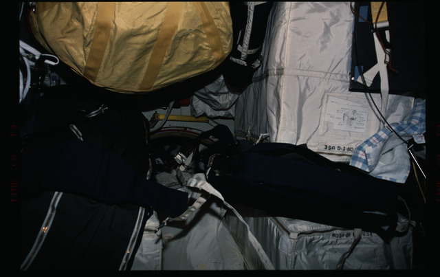 STS088-308-016 - STS-088 - Stowage bags on the Endeavour's middeck,near the airlock hatch