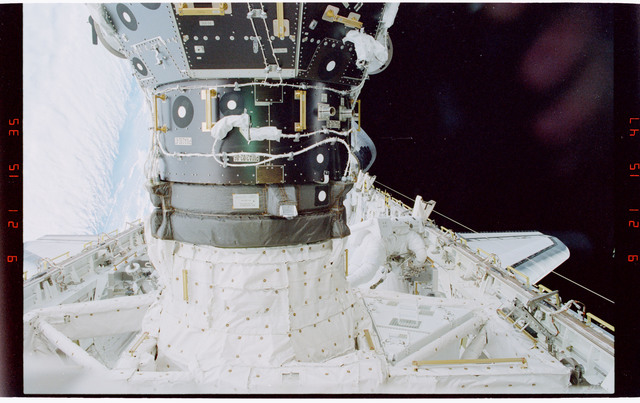 STS088-319-032 - STS-088 - Newman with portable foot restraint during EVA 3