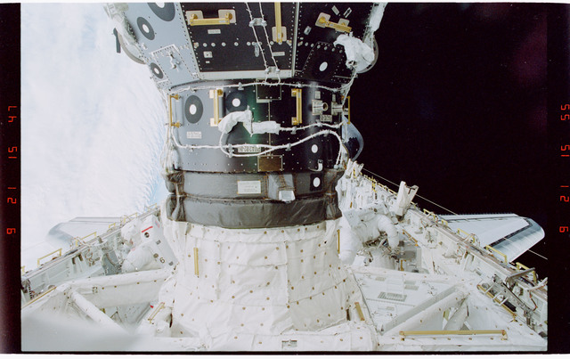STS088-319-033 - STS-088 - Newman with portable foot restraint during EVA 3