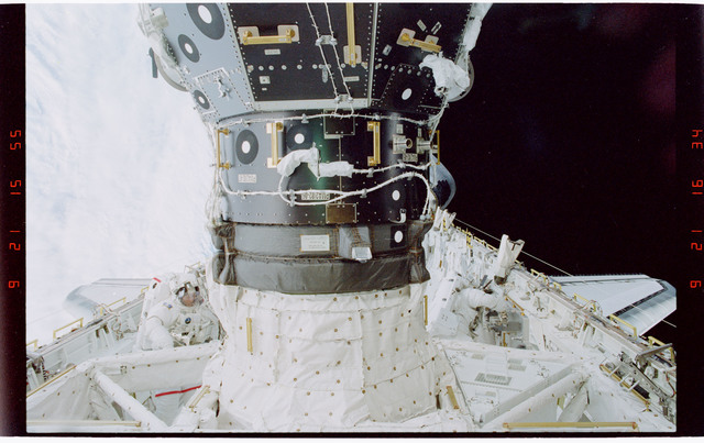 STS088-319-034 - STS-088 - Newman with portable foot restraint during EVA 3