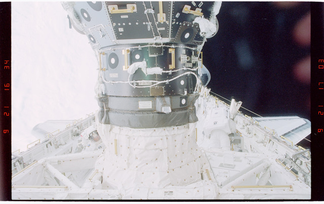 STS088-319-035 - STS-088 - Newman with portable foot restraint during EVA 3