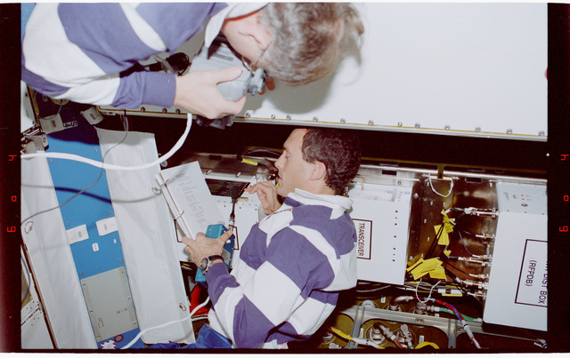 STS088-334-032 - STS-088 - Newman and Ross work on the Early Communications System in Node 1