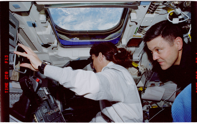 STS088-335-015 - STS-088 - View of the STS-88 crew on the flight deck during Node 1 grapple