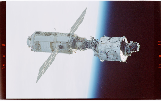 STS088-365-011 - STS-088 - View of the free-flying ISS taken during the fly-around by STS-88