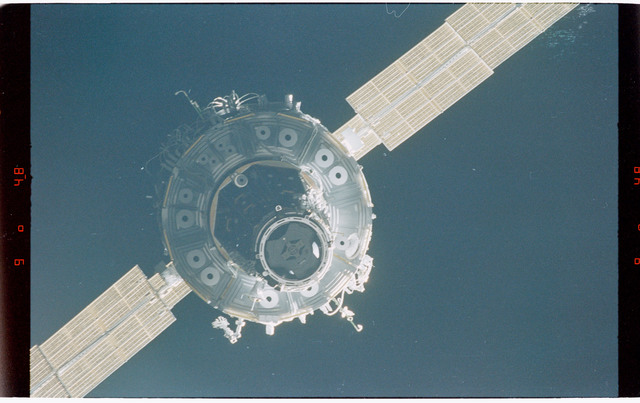 STS088-368-004 - STS-088 - Views of the free-flying ISS stack taken during fly-around by STS-88 mission