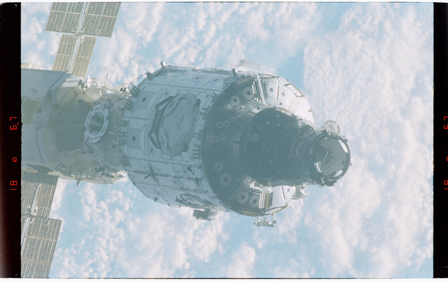 STS088-368-007 - STS-088 - Views of the free-flying ISS stack taken during fly-around by STS-88 mission