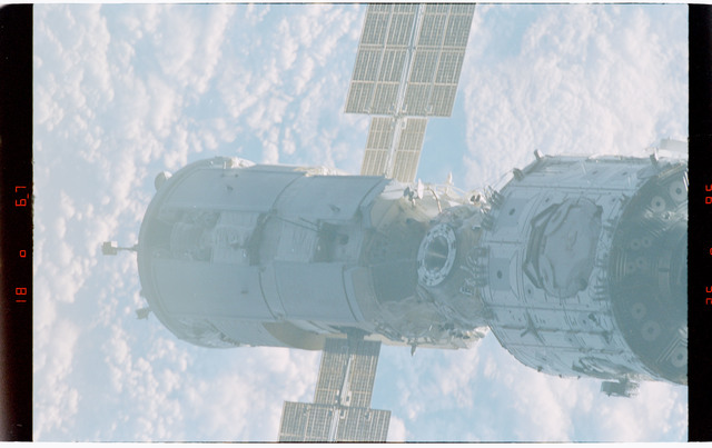 STS088-368-008 - STS-088 - Views of the free-flying ISS stack taken during fly-around by STS-88 mission