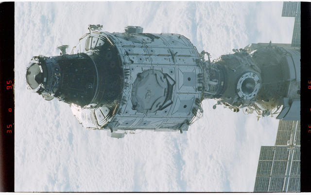 STS088-368-009 - STS-088 - Views of the free-flying ISS stack taken during fly-around by STS-88 mission