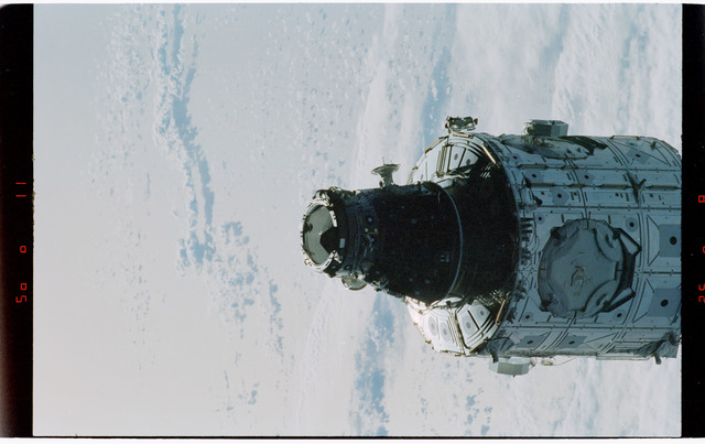 STS088-368-012 - STS-088 - Views of the free-flying ISS stack taken during fly-around by STS-88 mission