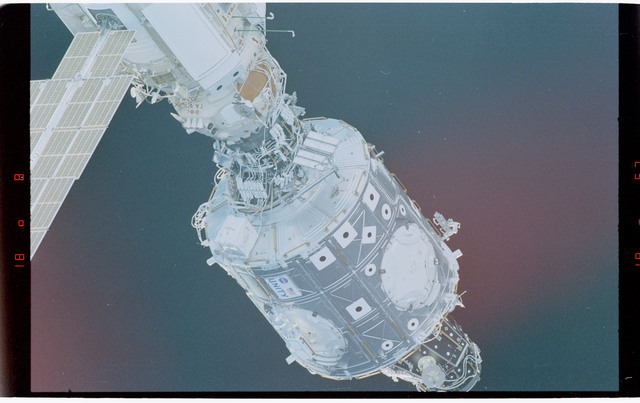 STS088-369-011 - STS-088 - View of the free-flying ISS stack taken during fly-around by STS-98