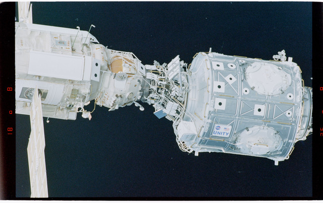 STS088-369-015 - STS-088 - View of the free-flying ISS stack taken during fly-around by STS-102
