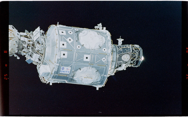 STS088-369-016 - STS-088 - View of the free-flying ISS stack taken during fly-around by STS-103