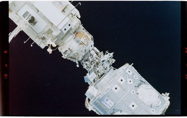 STS088-369-019 - STS-088 - View of the free-flying ISS stack taken during fly-around by STS-106