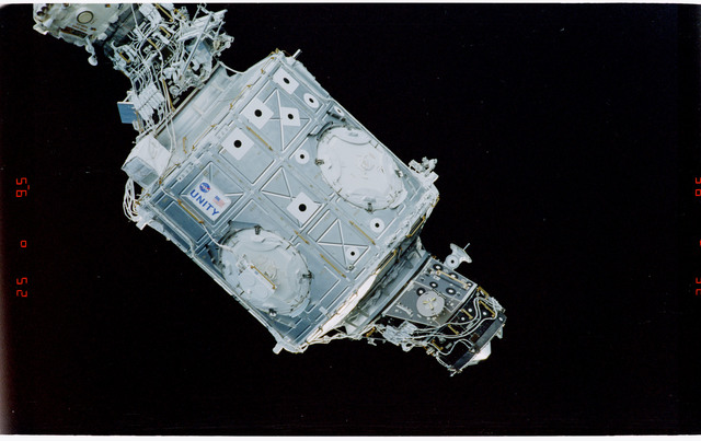 STS088-369-020 - STS-088 - View of the free-flying ISS stack taken during fly-around by STS-107
