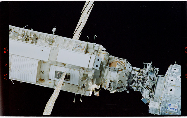 STS088-369-022 - STS-088 - View of the free-flying ISS stack taken during fly-around by STS-109