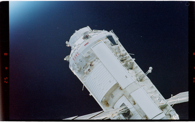 STS088-369-025 - STS-088 - View of the free-flying ISS stack taken during fly-around by STS-112