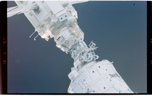 STS088-369-027 - STS-088 - View of the free-flying ISS stack taken during fly-around by STS-114