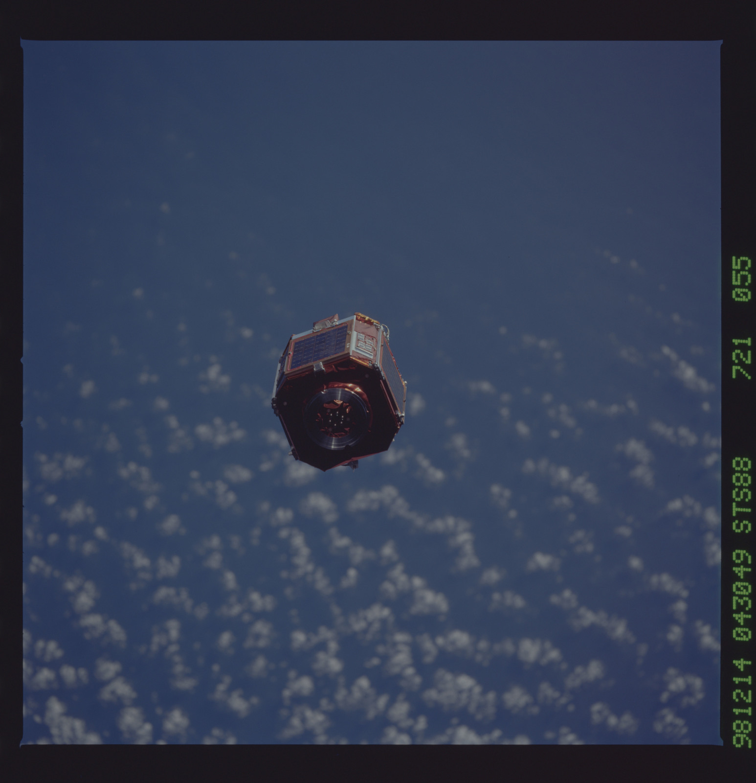 STS088-721-055 - STS-088 - SAC-A satellite in orbit over the Earth