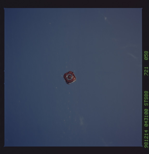 STS088-721-058 - STS-088 - SAC-A satellite in orbit over the Earth