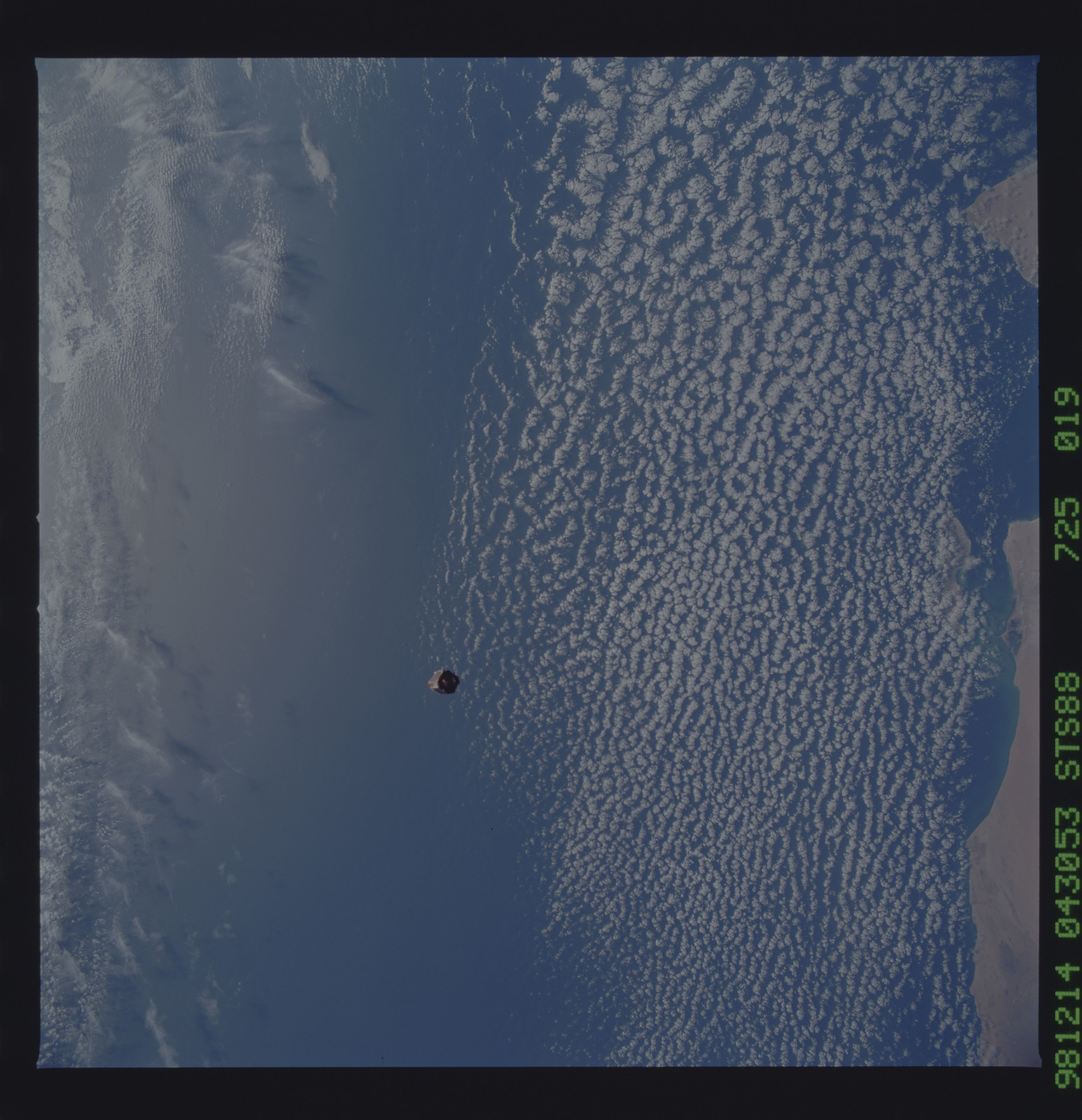 STS088-725-019 - STS-088 - SAC-A satellite in orbit over the Earth