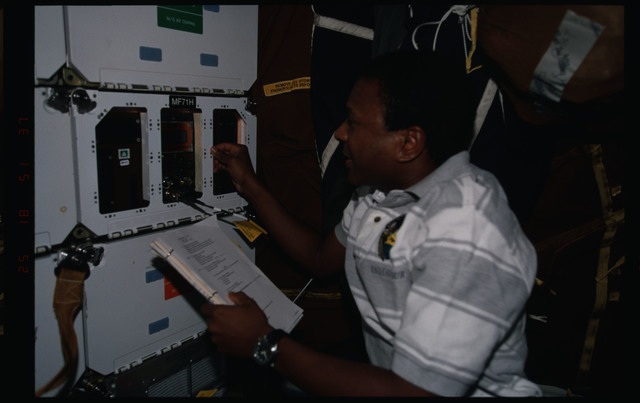 STS089-357-007 - STS-089 - MS Anderson checks on the CEBAS