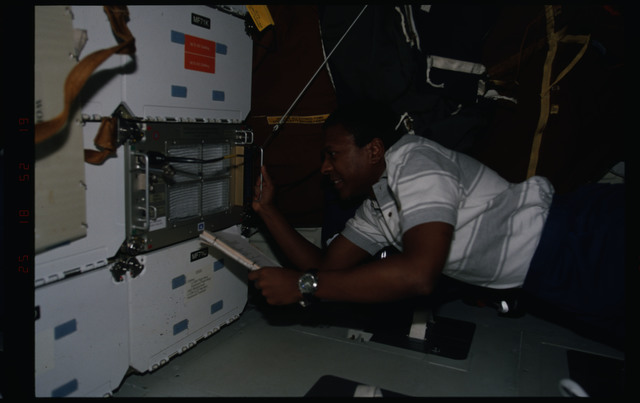 STS089-357-009 - STS-089 - MS Anderson works with the Cocult Biotechnology Refrigerator (BTR)