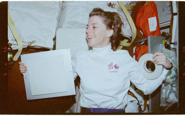 STS089-364-031 - STS-089 - MS Dunbar holds tape and a panel onboard middeck