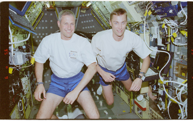 STS090-345-008 - STS-090 - Various views of STS-90 crew in Spacelab with personal FDF items