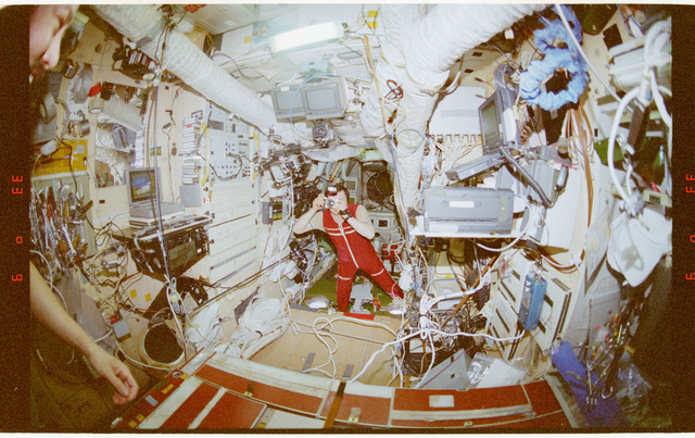 STS091-362-031 - STS-091 - Crewmember activity in the Mir Space Station Base Block and Kvant-2 module
