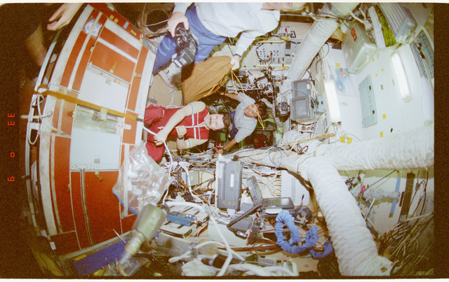 STS091-362-034 - STS-091 - Crewmember activity in the Mir Space Station Base Block and Kvant-2 module