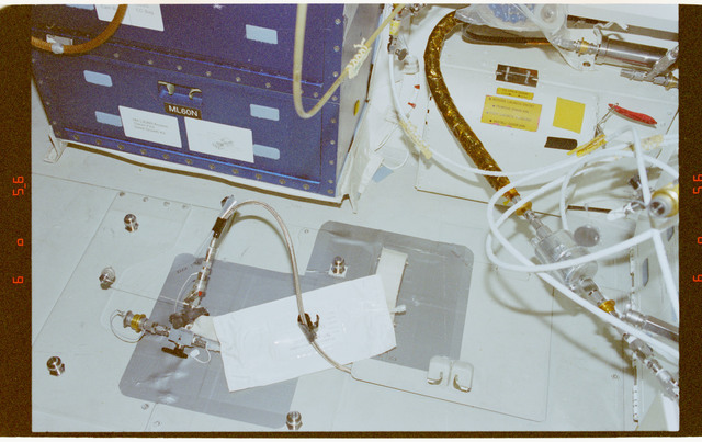 STS091-373-029 - STS-091 - RME 1331, water sampler on middeck floor
