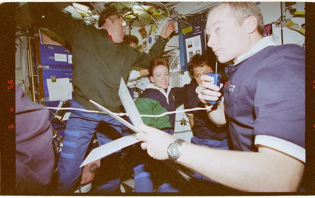 STS091-384-003 - STS-091 - Crewmember activity in the middeck and Spacehab